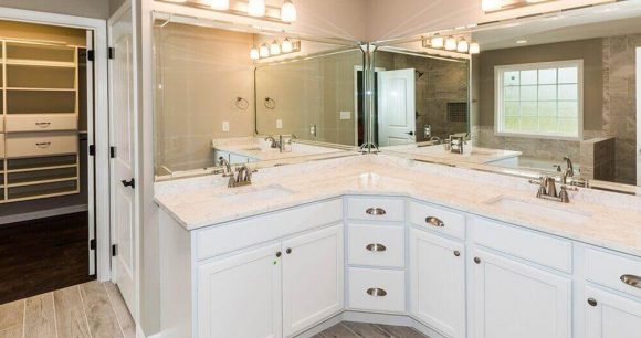 Custom white bathroom vanity installation